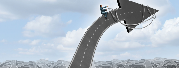 Leadership direction guidance business concept with a group of tangled streets and highways and a businessman guiding and steering the direction of an arrow road using a harness towards a planned goal for career and company success
